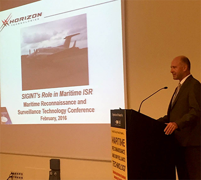 John Beckner speaks at the Maritime Reconnaissance and Surveillance event.